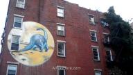 Grafiti de dinosaurio entre NoLIta y el East Village